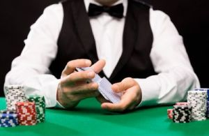 holdem dealer with playing cards and casino chips